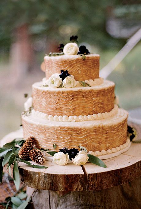 Faux-Bois Wedding Cake with Ranunculus. A faux-bois cake mirrored the rustic setting.