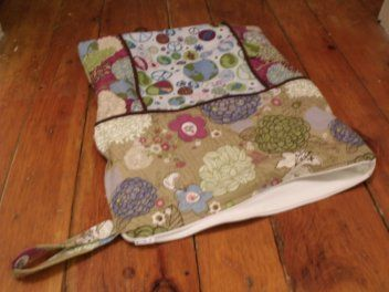 How to Make A Zippered Wet Bag Tutorial with a cute cotton print outer and a waterproof PUL inner lining.