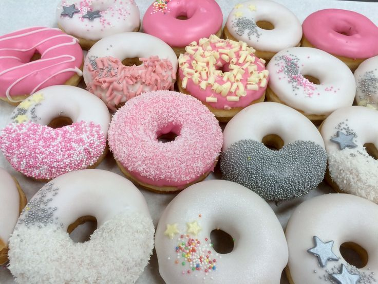 Donuts in white pink and silver with images donut shop