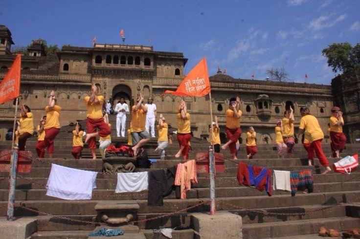 Garudasana efforts by International students at Maheshwar fort,Narmada river, near our Ashram, Paramanand Institute of Yoga Science and Research,India