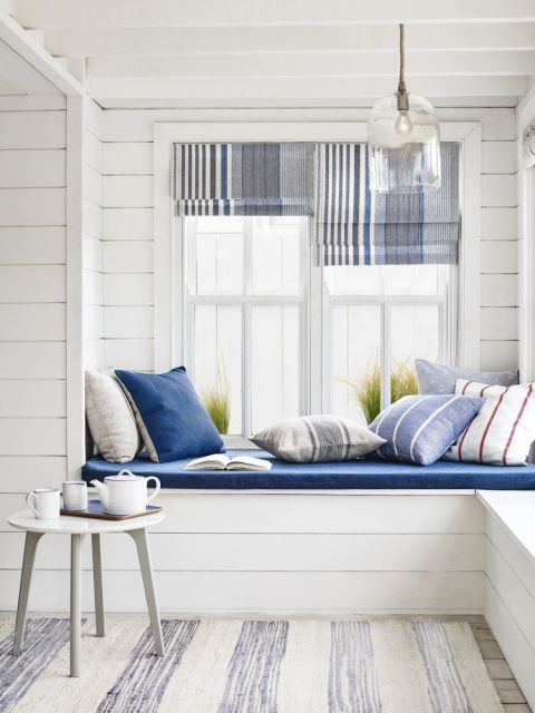 Give coastal style a sophisticated spin by using fabrics featuring different stripe widths and add touches of grey to the familiar blue and white palette. Mix and match a variety of striped fabrics for cushions and Roman blinds. At a wide window a single blind would save on cost but a pair of narrow blinds looks more relaxed and offers greater light control. Blinds made up in Anglesey Stripe, £22 a metre; Cloche glass ceiling pendant, £120; Dillon nest of two tables (one shown), £75…
