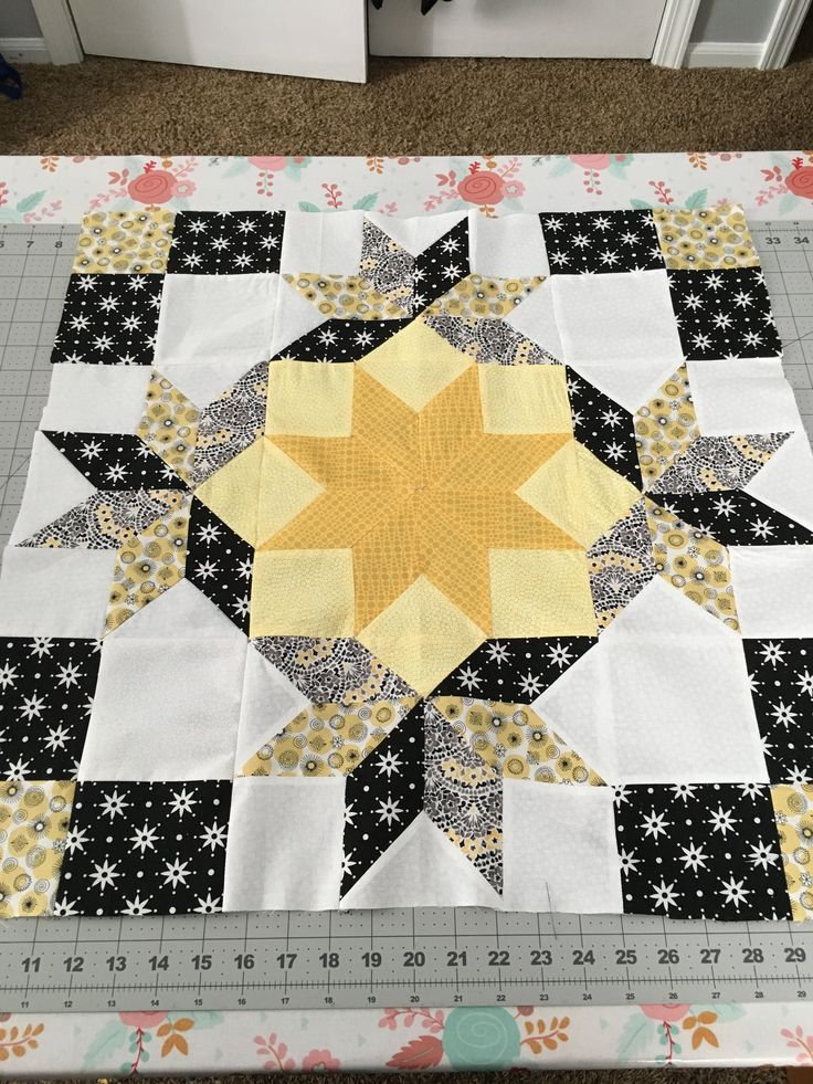 "24"" block in yellow and black from pattern Winter's Grandeur Mini Quilt. I'm going to use as a center for a stars themed block of the month just finishing up."