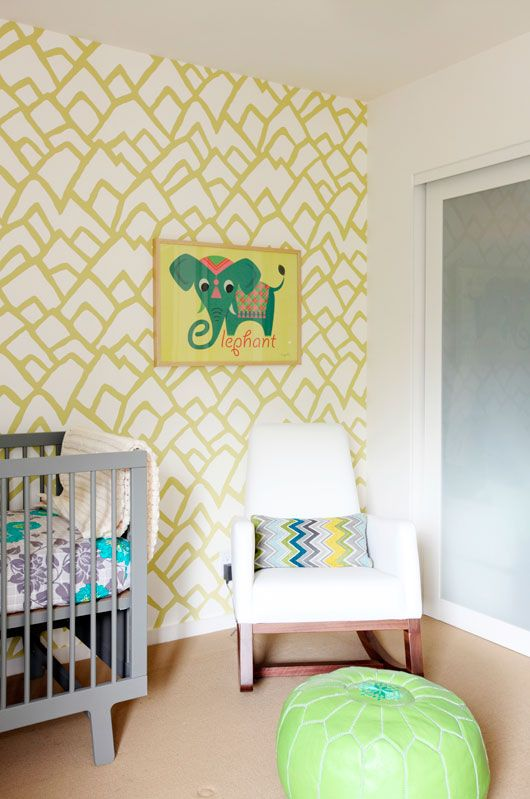 Zimba wallpaper by Schumacher in Soft Chartreuse; pouf, The Cross; Monte Joya Rocker; Oeuf 'Sparrow' crib in gray; print by Dilly Dally.