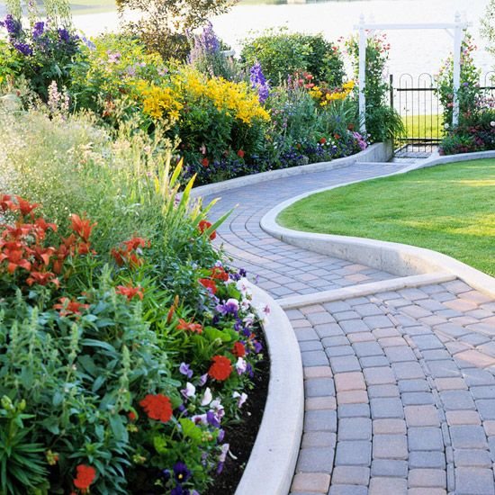 Concrete garden edging eases mowing, and its serpentine shape creates a winding path through the landscape shown here.