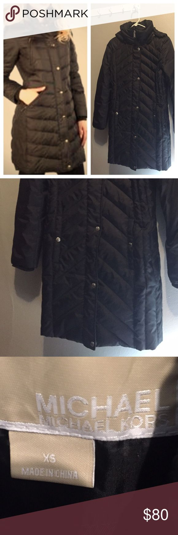 Michael Kors Puffer Coat Black MK Puffer coat size XS, removable hood, zips and buttons close. See pic 4 then pic 2, the very bottom button popped off, it doesn't show when it's zipped and buttoned and barely noticeable if you wear it open. Easy fix if you can sew or know someone who can fix it for you. Very, very warm. Will fit a small Michael Kors Jackets & Coats Puffers