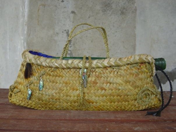 Kete with weka feathers and paua and koru design made to hold pounamu patu. Sent to the Chatham Islands as a gift for the opening of their marae from Arowhenua Marae.Made by me.