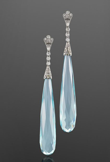 Art Deco Aquamarine and Diamond Pendant Earrings, circa 1920s  Two long aquamarine briolettes totaling approximately 55 carats are suspended on a line of round and rose cut diamonds mounted in platinum.