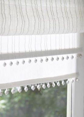 Linen curtain fabric blind with a pretty white braid