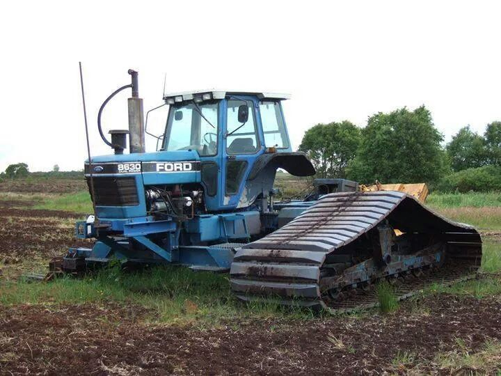 rollerman1:  Ford tractor on wide tracks  Ford 8630 on tracks