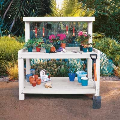 A simple, three-tier potting bench features a wire mesh backing that keeps your favorite hand tools right at your fingertips. #summerprojects #DIY
