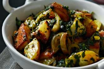 A quick and easy to make vegetarian curry side dish or snack for 2. Ideal for using up leftover roast potatoes and frozen spinach for speed