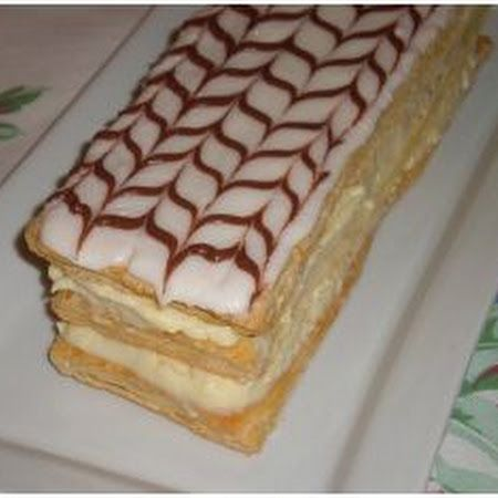 Napolean Pastry-Pastry Dough: ½ (17.3 oz pkg) Pepperidge Farm Puff Pastry (1 sheet) Pastry Cream: ½ c sugar ¼ c cornstarch 2 c whole milk or 1/2-&-1/2 4 egg yolks 1 t vanilla extract Icing: 1 c confectioners' sugar 2 t light corn syrup 2 T melted butter 1-2 T milk 1 T cocoa powder