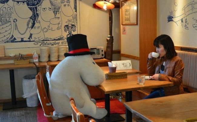 No friends? No problem! Japan's Moomin Cafe has stuffed toys to keep you company   Moomin Cafe is bringing new friendships to solo diners, in the shape of large stuffed Moomin dolls. But who are the Moomins, you ask? They're a community of wide-eyed hippopotamus-like creatures that appear in popular Swedish-Finnish children's books-and they've got a huge following.