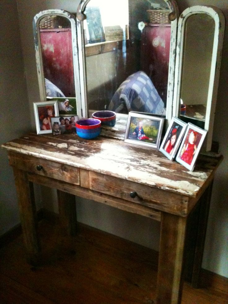 Makeup vanity made from recycled pallets, old bed frame and mirrors.