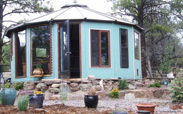 4_tiny_houses_in_New_Mexico.j Wooden Yurt: $20,000   This 320-square-foot round tiny house is on a lot in New Mexico and ideal for someone who is looking for rustic accommodations. It has a loft bedroom but no bathroom.