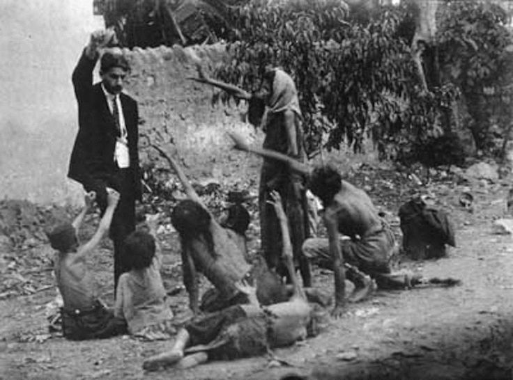 Turkish official teases starving Armenian children by showing them a piece of bread during the Armenian Genocide in 1915.