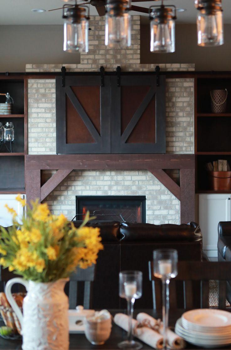 best 25 barn door over tv ideas on pinterest stone fireplace