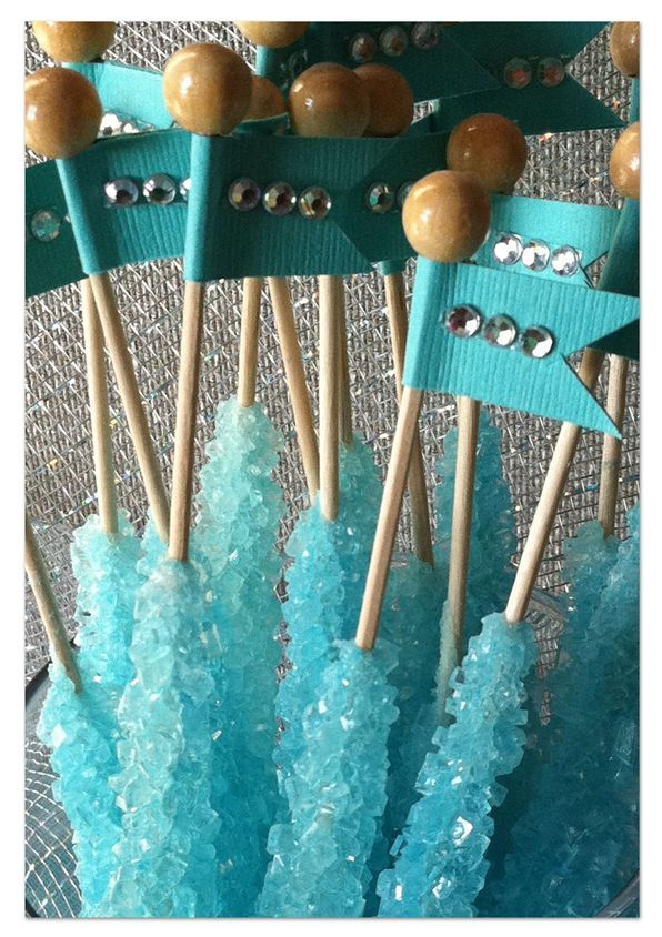 tiffany blue rock candy on a stick topped with custom flags and gems im probably going overboard by pinning sweet stuff but its all just so cute