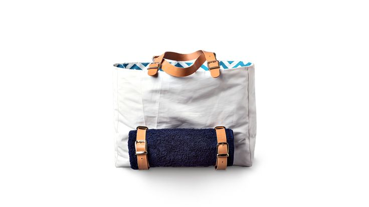Armathea - the Beach Bag We designed our beach bag with waterproof teflon coated lining to keep the water out of the inside and a beach towel holder outside so you can keep everything separated as needed. Request@valefyachts.com