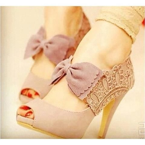 Pink bowe heels with lace overlay on the sides