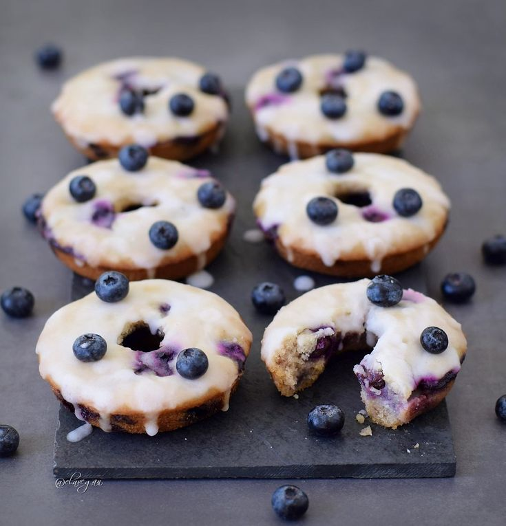 Baked blueberry donuts with a lemon glaze. These blueberry donuts are vegan, gluten free, refined sugar free, healthy and delicious. Easy to make recipe!