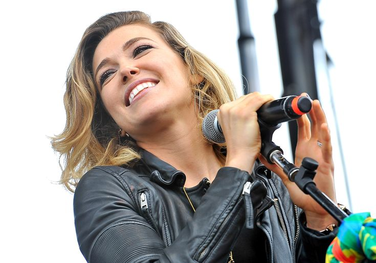 "Rachel Platten's ""Fight Song"" has already garnered her a guest appearance on Taylor Swift's tour, become a song of the summer contender and (probably) burned itself into your brain. Now, it's a PSA for Girl Scouts, too.  Platten visits with four Girl Scouts in a new video, and talks to them about strength, empowerment and the meaning behind ""Fight Song."""