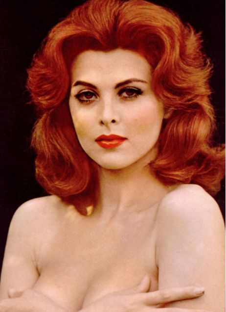 "Tina Louise, red-headed American actress, singer and author, who played movie star Ginger Grant in ""Gilligan's Island"" (1957)"