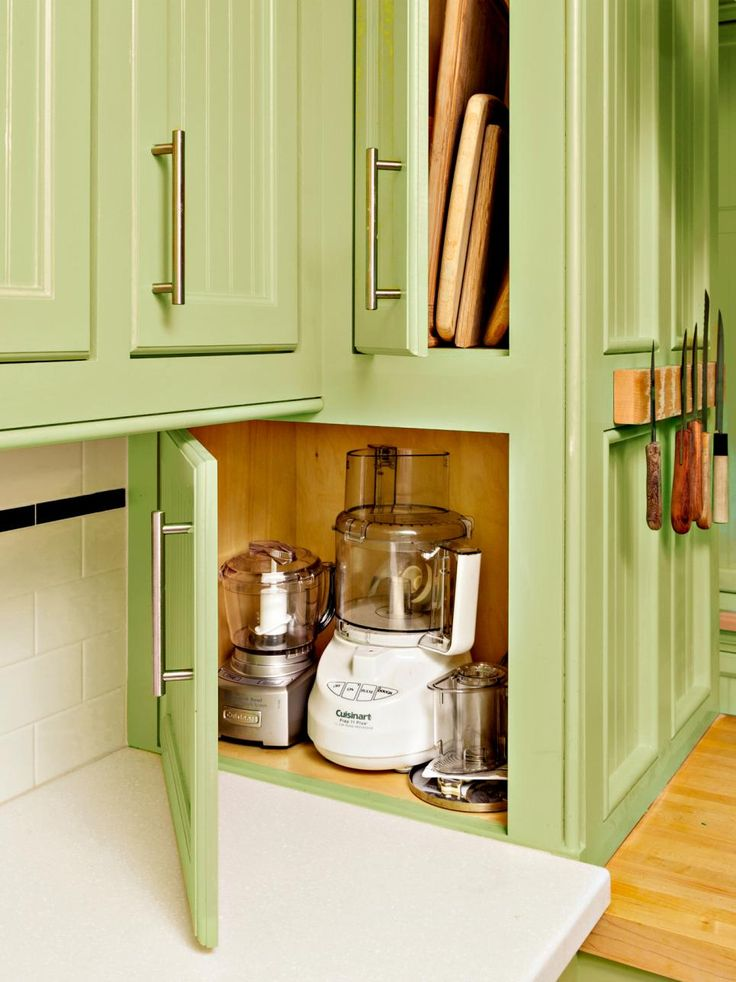Since they were already splurging on custom cabinets, the Fryes got creative with some of the awkwardly located nooks. Instead of wasting precious storage space, they maxed out tiny cubbies by giving them specialized functions. For instance, they built an appliance garage at counter level and a cutting board bay next to the prep counter.