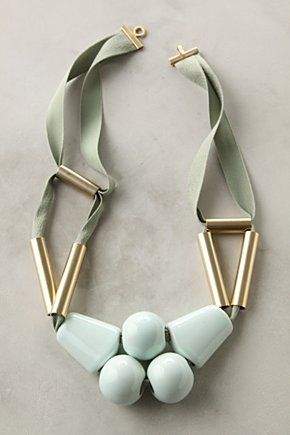 "$378 Collier Pistache Necklace  Immense ceramic pearls and fans of pale green dangle below gleaming, brushed-brass tubes and soft cording. Handmade in France by Marion Vidal.  Hook clasp  Ceramic, brass, polyester  22.5""L  5"" bib  Handmade in France"