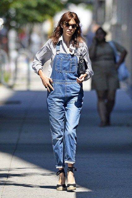 New York - June 20 2013  Alexa Chung remains an avid devotee to the dungarees trend - wearing hers with a striped shirt and espadrille wedges.