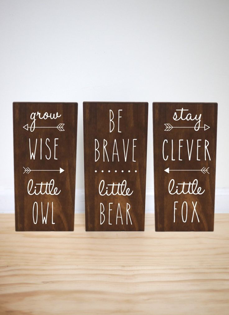 An adorable addition to a woodland themed nursery! This collection of three solid pine wood signs features a dark walnut stain and white lettering. Signs will arrive sealed with a matte finish and ready to hang!  ►SIZE OPTIONS- Each individual sign measures: 5.5 x 12 in. 7.5 x 15 in. 9.5 x 20 in.  ►DETAILS - 3 solid pine wood signs - Dark walnut stain - White lettering - Sealed with a matte finish for protection - Ready to hang! (sawtooth hangers installed in back of signs)  View more from…