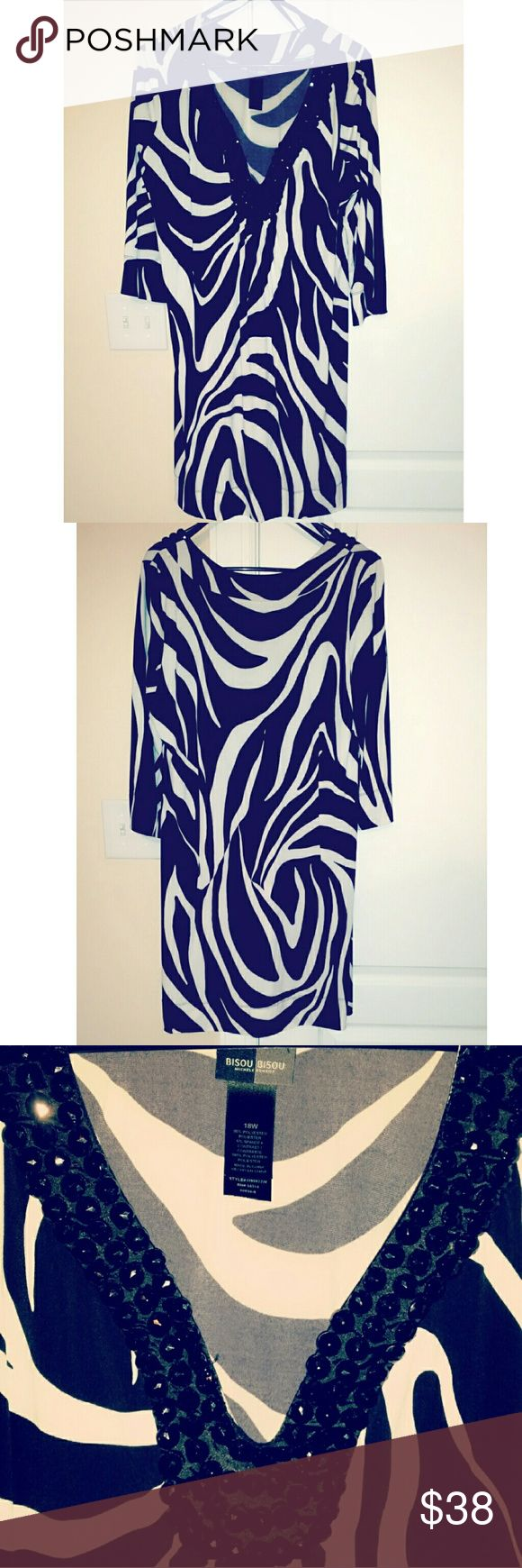 """Bisou Bisou 18w Zebra Print Dress Make a statement this holiday season with this gorgeous size 18w Bisou Bisou zebra print dress. Three quarter length sleeves (17.5"""" in lenght) with a beautiful accented jeweled v-neckline.  Dress length is approximately 38"""". Excellent condition, smoke free, one cat home Bisou Bisou Dresses Midi"""