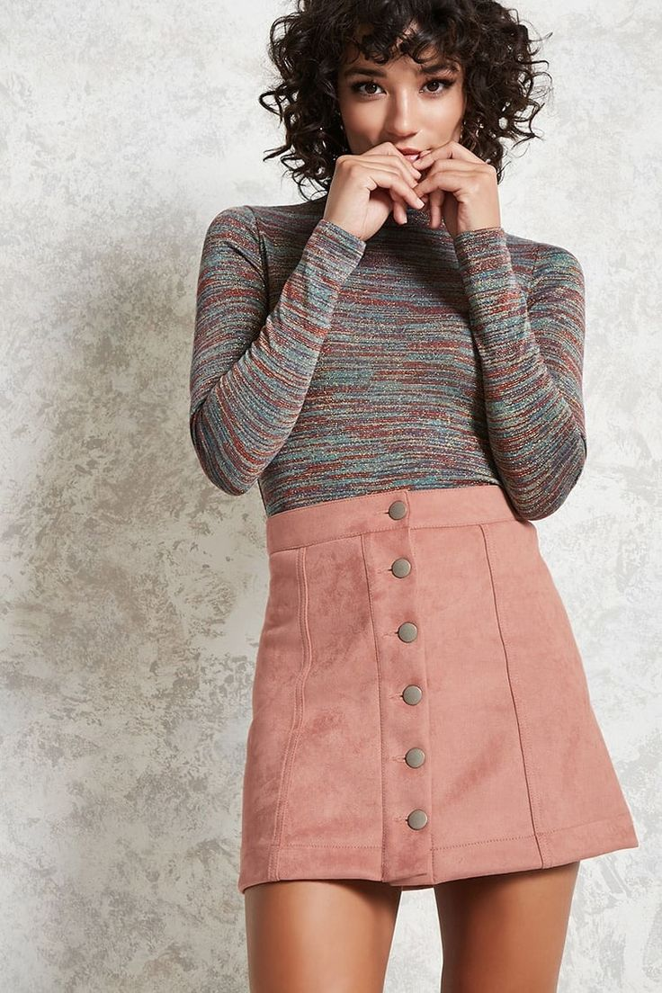 A faux suede mini skirt featuring exposed button-front closures and panel seam construction.