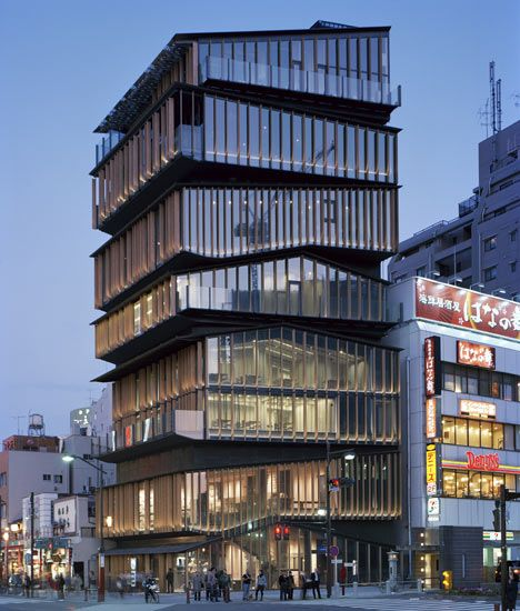 This visitor centre in Tokyo by Japanese architects Kengo Kuma and Associates looks like a stack of smaller buildings with sloping roofs.