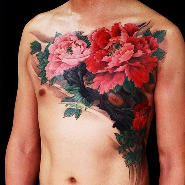 Japanese peony chest tattoo by @zhiyong_tattoo.  #japaneseink #japanesetattoo #irezumi #tebori #colortattoo #colorfultattoo #cooltattoo #largetattoo #chesttattoo #flowertattoo #peonytattoo #photorealism #realistictattoo #wavetattoo #naturetattoo