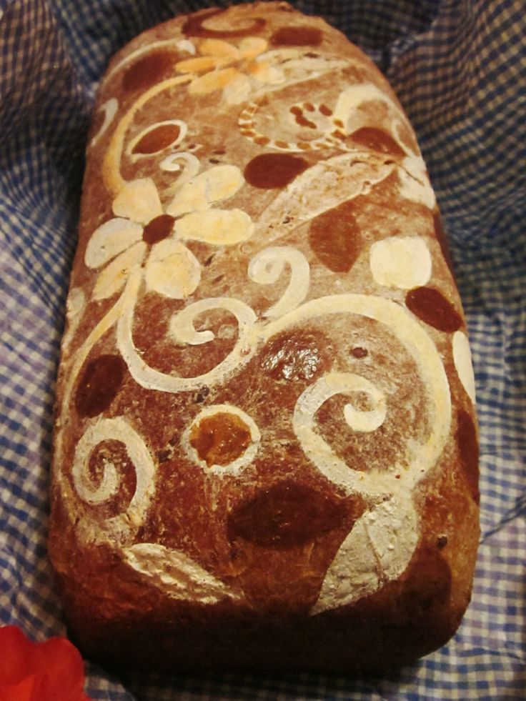 Basic Bread Painting Technique ( http://cheftessbakeresse.blogspot.com/2009/06/basic-bread-painting-technique.html )