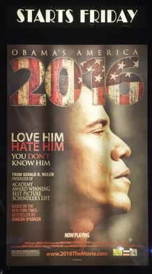 """A promotional poster is seen at the Rave Fairfax Corner movie theater in Fairfax, Virginia, announcing the new movie """"2016: Obama's America"""" that opened in theaters across the US, August 24, 2012."""