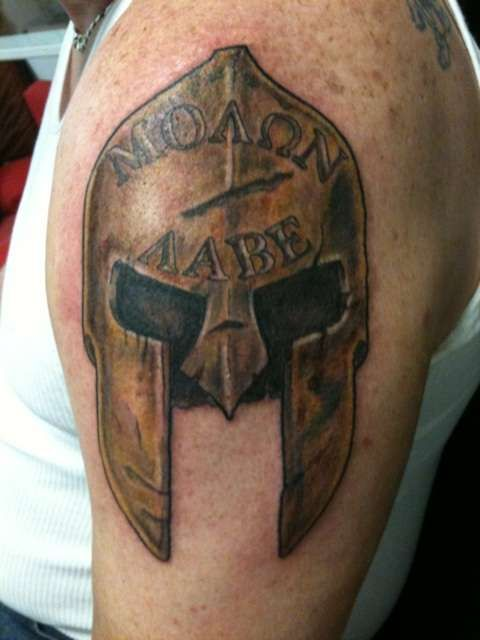 spartan helmet tattoo. needs the mohawk on top of the helmet
