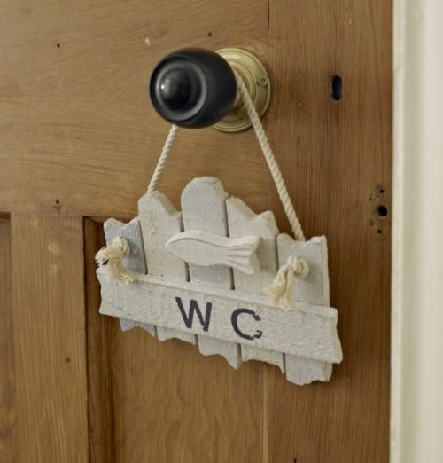 'WC' blue  white hanging toilet sign - Melody Maison® Wooden 'WC' toilet sign  Distressed nautical style toilet door or wall sign  In white and pale blues  Would look ideal hung in a bathroom or hanging from your door!  Cream hanging rope to make hanging easy  Measures 18 cm wide x 14.5 cm wide   When hanging it would measure 20 cm high