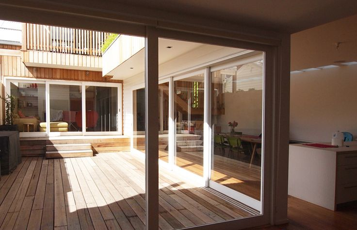 2 Lane House. ITN Architects take advantage of two laneways beside a simple Victorian weatherboard. The new two-storey extension wraps around three edges of the site,creating an internal courtyard garden with balconies above