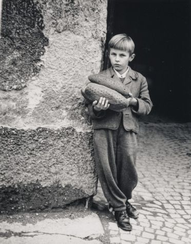 Boy with Two Loaves of Bread Kazys Daugėla, 1945-1949/~1980  glossy photographic paper, silver bromide photography, 35.00 x 27.50 cm