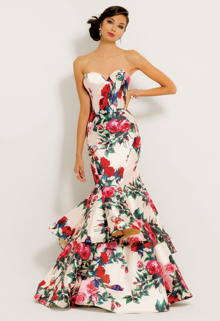 Look and feel like a floral princess in this gorgeous evening gown! With its strapless sweetheart neckline, floral print pattern, and tiered mermaid skirt, this long prom dress is an absolute gem. #CLVprom17 #camillelavie