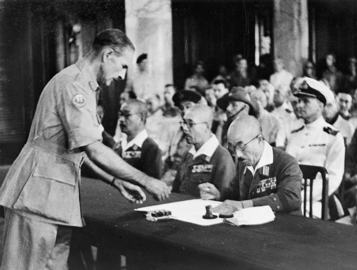 A member of the Japanese delegation signs the document of surrender in Singapore on 12 September 1945.