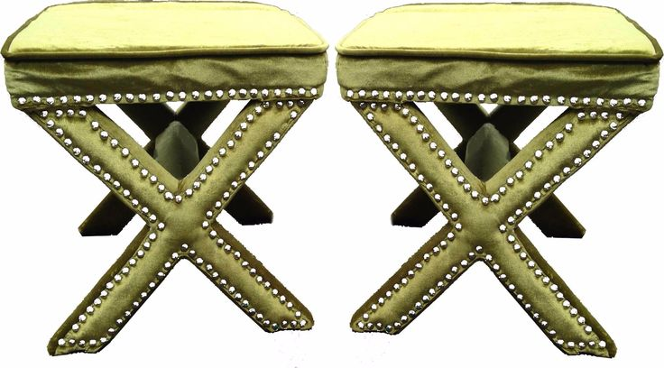 """Add a splash of color to your living room with this pair of green velvet X-bench ottoman-style stools. Embellished with classic nailhead trim. Just 1 nailhead is missing. Each stool is 19""""W x16""""D x 17""""H."""