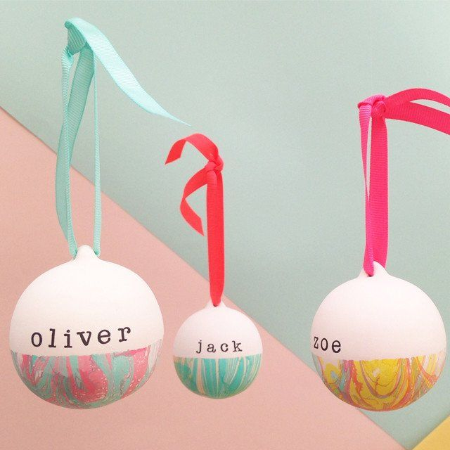Marbled and Personalised ceramic baubles. Hand marbled in a choice of colours with complementary ribbons and a message of your choice