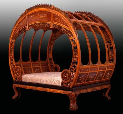 moon bed at the pem museum.  Made in China in the late 19th-century, this work is a tour-de-force of extravagant carving and ornate inlay. Composed of 53 separate pieces, the Moon Bed is held together with only wooden pegs and wedges and takes 5-6 people to properly assemble.