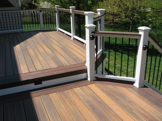 Fiberon ipe with tudor brown picture framing vinyl for Low maintenance decking