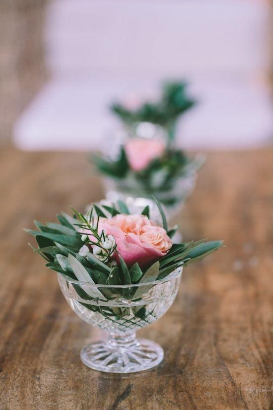 small olive leaves and flower in china goblet #weddingdetails #tabledecor #weddingchicks http://www.weddingchicks.com/2014/03/31/vintage-mediterranean-wedding/