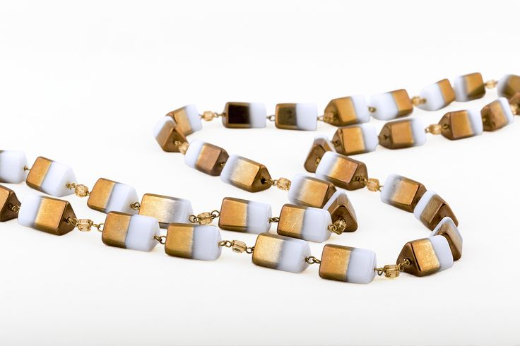 Gold and white glass beads chain. Perfect for all day and corporate wear. Simple Rich and classy!