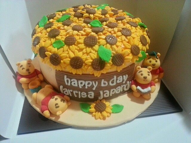 Winnie the pooh cake with sunflowers